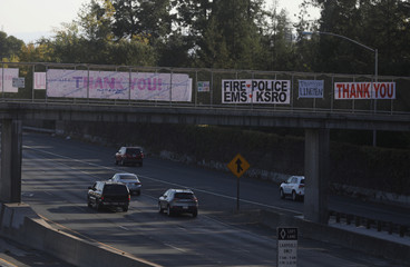 Thank you banners to responders are hung above Highway 101 after wildfires tore through portions of Santa Rosa