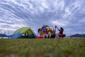 Poster Camping Group of Young Asian Camper Enjoy Camping Outdoors . Holiday , vacation , summer concept .