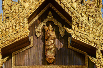 myanmar art wooden craft of angle image on wooden wall at shwedagon pagoda south gate in yangon city.shwedagon pagoda is famous place and important landmark for buddhism and tourist in yangon,myanmar