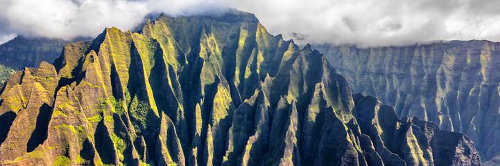 Hawaii travel aerial background of Na Pali coast, Kauai, Hawaii helicopter view. Nature coastline landscape in Kauai island, Hawaii, USA. Panoramic banner crop.