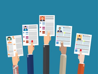 Hands holding cv resume documents.
