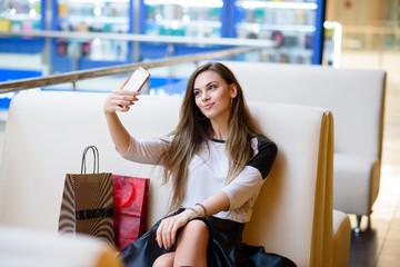 Girls make selfi shopping.