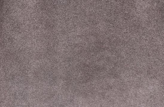 Plain gray color carpet texture. Pale smooth carpet. Velvet paper background
