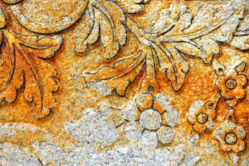 Vintage Thai Sculpture on Stone Wall.