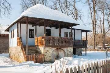 Old traditional Romanian house in winter at the Village Museum 'Dimitrie Gusti' in Bucharest