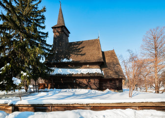 Beautiful Romanian heritage timber Church in a winter setting