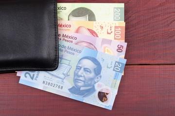 Mexican Pesos in the black wallet