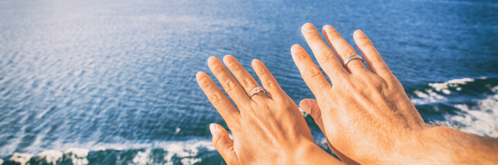 Cruise honeymoon travel vacation for newlyweds couple showing wedding rings on hand selife at ocean view resort background. Luxury holidays panoramic banner.