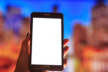 Woman using her Mobile Phone in the street, night light Background soft focus picture