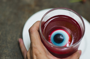 jelly with eyes on Halloween. red eye  in red jelly in a glass. halloween concpet