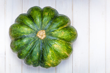 A large green pumpkin on a white background. Thanksgiving Day. Halloween.