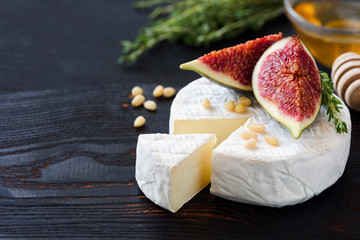 White cheese brie or camambert, figs, honey and nuts