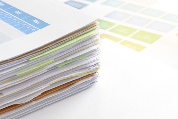 Stack of financial documents on desk at workplace,business concept.