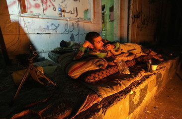 A Free Syrian Army fighter rests in the town of Tadef in Aleppo province
