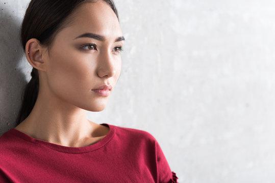 Serious elegant asian girl woman is expressing hopeless