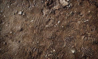Wet ground with footprints. Mud ground with human footprints. Soil background Fototapete