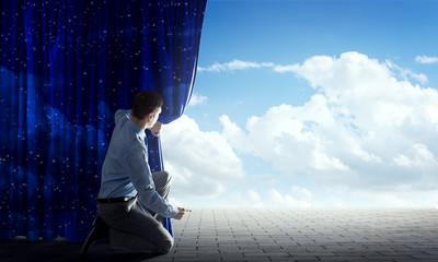 Blue sky behind curtain