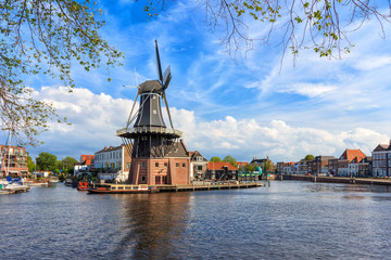 Picturesque landscape with a windmill of the Dutch city of Haarlem.
