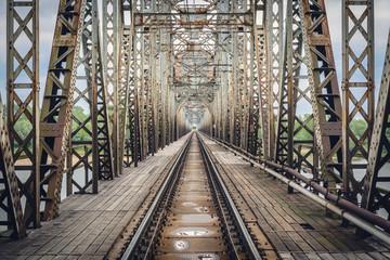 Poster Bridge Rusty steel railroad bridge over Vistula River in Gora Kalawaria, Masovian Province of Poland