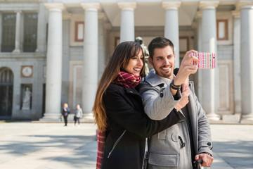 couple taking pictures at prado museum madrid