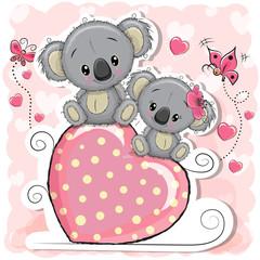 Two Koalas is sitting on a heart