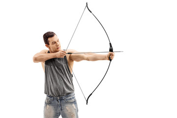 Young man aiming with a bow and arrow