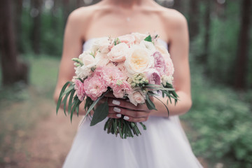 A bouquet in the hands of the bride.