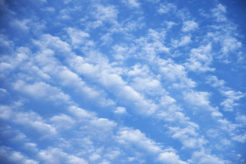 Beautiful pattern of white clouds on blue sky background, nature background of cloud on blue sky in the daytime.