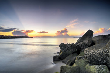 beautiful sea view scenery over stunning sunrise background.sunlight beam and soft wave hitting sandy beach