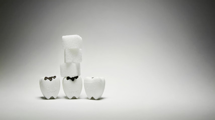 Cubes sugar on decayed tooth model in bad and sad emotion 3