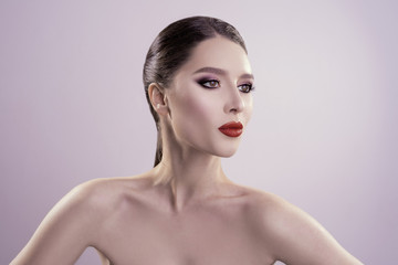 beautiful portrait with red lips in the studio. fresh clean skin. high qauality image.