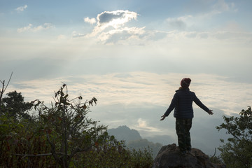 Tourist is standing on the top of the hill for take a look the beautiful scenery in the morning.