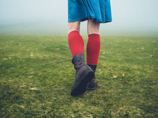 Woman in hiking boots and socks on the moor