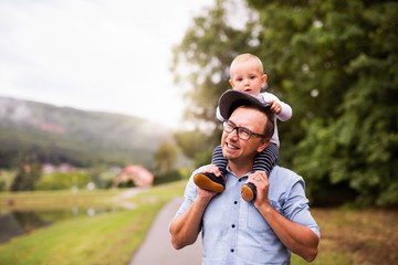 Father and little boy in nature in summer.