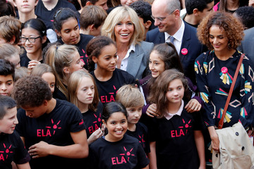 Brigitte Macron, wife of the French President, poses with school children after giving them a dictation in support of ELA, European Leucodystrophie Association, at a school in Paris