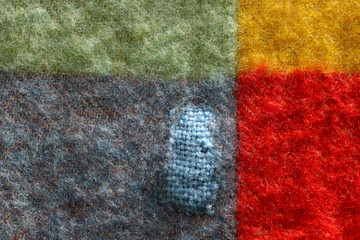 repaired hole in a woolen blanket