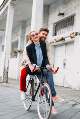Smiling Couple on a Bike.