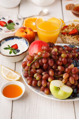 Fresh healthy breakfast with fruits closeup