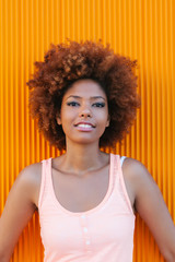 Latin American Afro Woman Against an Orange Background in a Summer Day