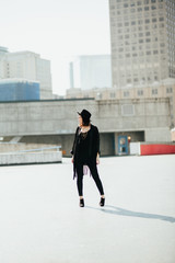 Young fashionable women posing on rooftop