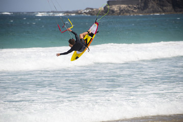 kiters in jumping with surfboard