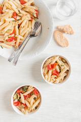 Pasta salad with cherry tomatoes and zucchini