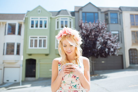 Young woman using her smart phone