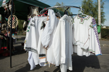Traditional Romanian white shirts on hangers