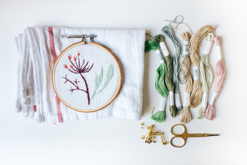 Sewing and Embroidery Kit Arranged on a White Background