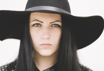 closeup of young woman with black hat