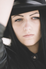 closeup of young woman wearing hat .