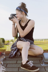 Teen takes picture with  camera