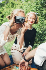 Two Blond Women Having Fun With Old Film Camera on Sunny Day in Nature