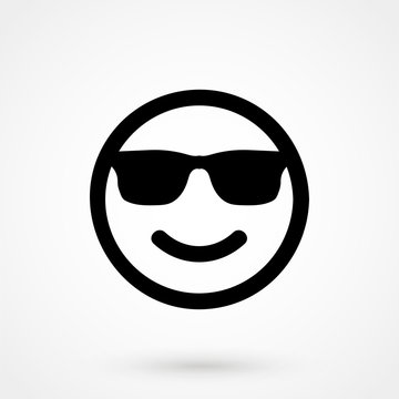 Smiley face with sun glasses vector icon.